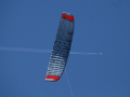 The 21m2 ram-air wing of the EnerKite system with airliner cruising at very high altitude